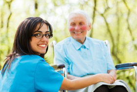 Smiling caregiver and elderly man