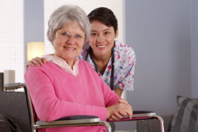 Smiling caregiver and eldery woman