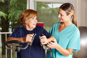 Caregiver assisting the elderly woman