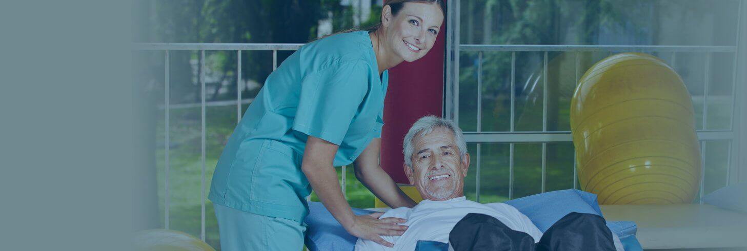 Caregiver and elderly man doing exercise