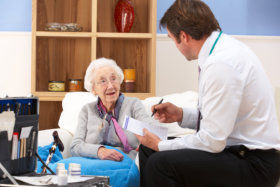 Doctor assisting the elderly woman